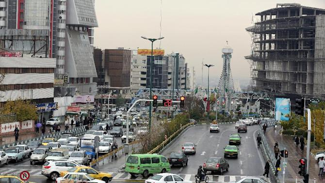 Iranians drive on a street in the capital Tehran on November 25, 2014