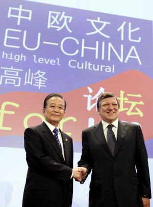 China's Prime Minister Wen Jiabao, left, shakes hands with European Commission President Jose Manuel Barroso during an EU China cultural exchange at EU headquarters in Brussels on Wednesday, Oct. 6, 2010. The EU and China meet for a formal summit on Wednesday to discuss the trade gap and currency issues. (AP Photo/Virginia Mayo)