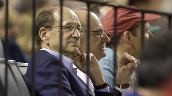 FILE - In this June 26, 2015, file photo, St. Louis Cardinals owner Bill DeWitt Jr. watches during the eighth inning of a baseball game between the Cardinals and the Chicago Cubs in St. Louis. The federal hacking investigation of the Cardinals could take longer if high-level executives are implicated in the breach of the Houston Astros' database, according to legal experts. (AP Photo/Jeff Roberson, File)