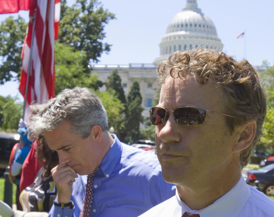 Rep. Joe Walsh, R-Ill., left, and Sen. Rand Paul, R-Ky. attend a Tea Party rally on Capitol Hill in Washington, Wednesday, July 27, 2011. (AP Photo/Harry Hamburg)