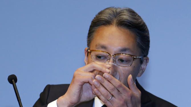 Sony Corp. President Kazuo Hirai drinks water during a press conference at the company's headquarters in Tokyo Wednesday, Sept. 17, 2014. Sony expects its annual loss to swell to $2 billion and has canceled dividends for the first time in more than half a century after writing down the value of its troubled smartphone business. Citing intense competition, especially from Chinese rivals, Sony said it anticipates a net loss of 230 billion yen ($2.15 billion) for the fiscal year that ends March 31, 2015. (AP Photo/Toru Takahashi)