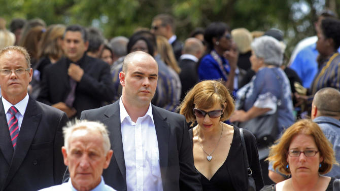 Adam Steenkamp, centre left, the brother of Reeva Steenkamp, walks with family members after attending her funeral,  in Port Elizabeth, South Africa, Tuesday, Feb. 19, 2013. Olympic athlete Oscar Pistorius is charged with the murder of Reeva Steenkamp on Valentine's Day. The defense lawyer says it was an accidental shooting. (AP Photo/Schalk van Zuydam)