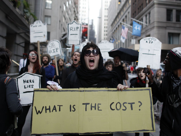 Protestors chant during an Occupy Wall Street march, Monday, Sept. 17, 2012, in New York.  A handful of Occupy Wall Street protestors were arrested during a march on the New York Stock Exchange on the