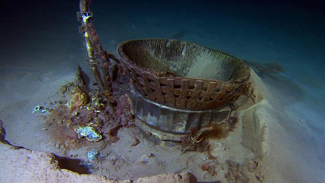 This image provided by Bezos Expeditions shows a thrust chamber of an Apollo F-1 engine on the bottom of the Atlantic Ocean in March 2013. An expedition led by Amazon CEO Jeff Bezos pulled up two rocket engines, including this one, that helped boost Apollo astronauts to the moon. Bezos and NASA announced the recovery on Wednesday, March 19, 2013. The sunken engines were part of the Saturn V rocket used to bring astronauts to the moon during the 1960s and 1970s. After liftoff, they fell into the ocean as planned. (AP Photo/Bezos Expeditions)