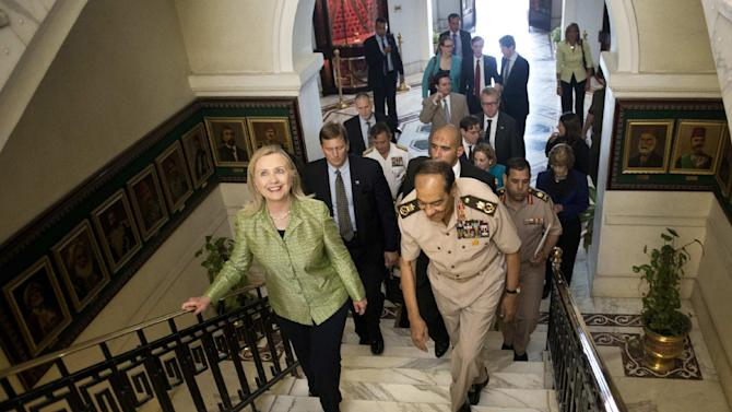 Field Marshal Hussein Tantawi walks with US Secretary of State Hillary Rodham Clinton to a meeting at the Ministry of Defense July 15, 2012 in Cairo, Egypt. Clinton was holding talks with Egypt's top military leaders, just hours after calling for them to help smooth the country's full transition to democracy. (AP Photo/Brendan Smialowski, Pool)
