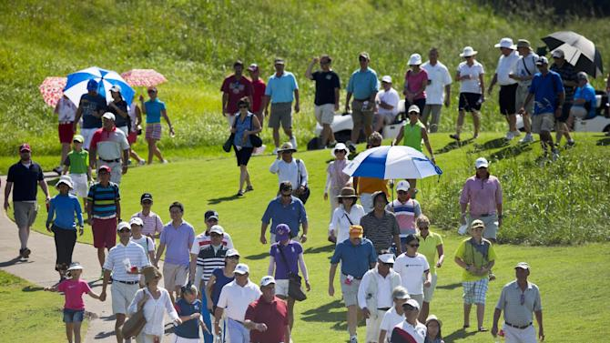 Fans walk the path as they follow the leaders during the final round of the LPGA Classic golf tournament at Capitol Hill on Sunday, Sept. 21, 2014, in Prattville, Ala. (AP Photo/Brynn Anderson)