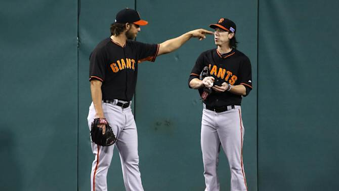 San Francisco Giants starting pitchers Madison Bumgarner, left, and Tim Lincecum stand in the outfield at PNC Park in Pittsburgh during a  team workout Tuesday, Sept. 30, 2014. Bumgarner gets the start against Pittsburgh Pirates' Edinson Volquez in Wednesday night's  National League Wild Card baseball game in Pittsburgh. (AP Photo/Gene J. Puskar)