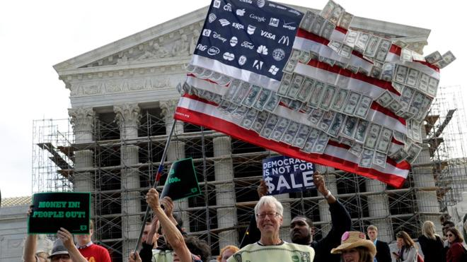 Demonstrators gather outside the Supreme Court while the court hears arguments on campaign finance.