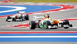 Adrian Sutil of Germany and Paul di Resta of Britain drive during the third practice session of the U.S. F1 Grand Prix at the Circuit of the Americas in Austin