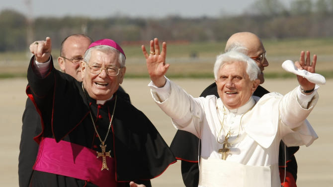 FILE -- In this file photo taken at Andrews Air force Base, Md., in this file photo dated April 15, 2008 Pope Benedict XVI, right, is seen with Papal Nuncio Pietro Sambi. The Vatican says its ambassador to the United States Archbishop Pietro Sambi has died in a U.S. hospital after suffering complications after recent lung surgery. The 73-year-old Sambi died Wednesday in Johns Hopkins Hospital in Baltimore where he had been placed on assisted ventilation. He had undergone surgery two weeks ago. The Italian prelate had served as papal representative in Washington since 2006, one of Pope Benedict XVI's first major appointees. (AP Photo/Gerald Herbert, File)