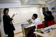 Students at Rinkeby's middle school discuss the Nobel Prize on October 2, near Stockholm. Every year since 1992, the Rinkeby School's third form students have spent a term studying the Nobel Prize, at the end of which they are rewarded with a highly publicised visit by one of the laureates