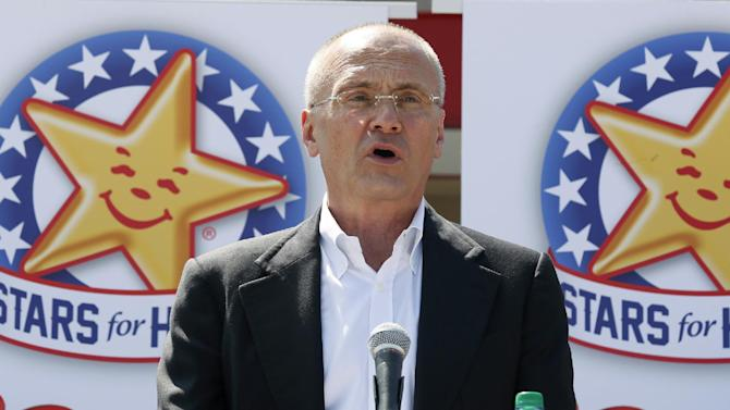 In this Aug. 6, 2014 photo provided by CKE Restaurants, company CEO Andy Puzder speaks at a news conference in Austin, Texas, to highlight Carl's Jr.'s commitment to the state. Carl's Jr. and Hardee's ads featuring starring nearly naked women have become a part of American culture, according to Puzder. (Jack Plunkett/CKE Restaurants via AP)