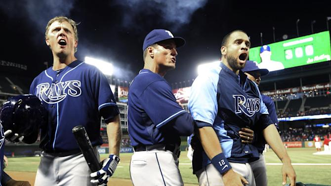 Tampa Bay Rays' Shelley Duncan, third base coach Tom Foley, center, and James Loney (21) yell at the umpires, not shown, as they walk off the field after the final strike called to end a baseball game against the Texas Rangers, Monday, April 8, 2013, in Arlington, Texas. The Rangers won 5-4. (AP Photo/LM Otero)
