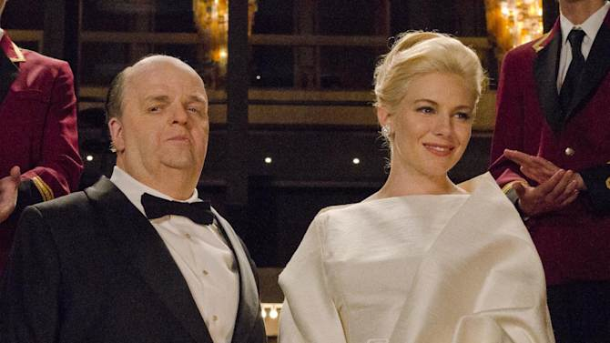 "This image released by HBO shows Toby Jones, portraying Alfred Hitchcock, left, with Sienna Miller, portraying Tippi Hedren, in a scene from the film ""The Girl,"" premiering Saturday, Oct. 20, 2012 at 9 p.m. EST. The HBO movie dramatizes the making of Hitchcock's ""The Birds"" and his relationship with Hedren. (AP Photo/HBO, Kelly Walsh)"