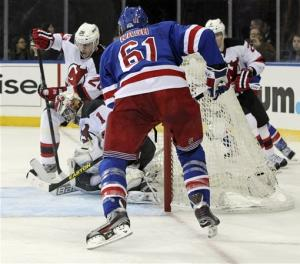 Rangers avoid 8th place, top Devils 4-0 in finale
