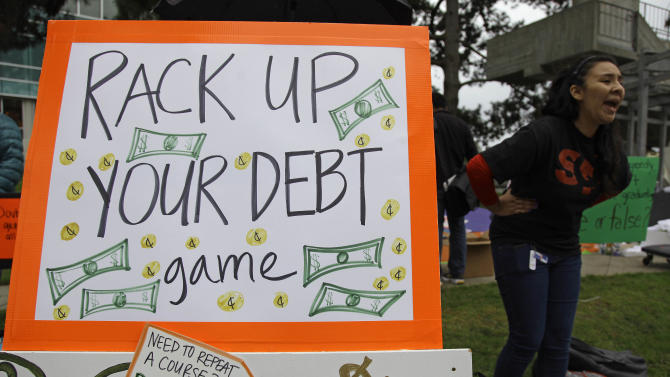 In this photo taken Thursday, Nov. 8, 2012 Victoria Huerta yells during a protest against higher student fees at San Francisco State University in San Francisco. Deep cuts in state funding have forced California State University to turn away tens of thousands of qualified students because campuses can't accommodate them. After gentler efforts to prod super seniors to graduate, Chancellor Charles Reed wants to start charging them hefty out-of-state tuition once they reach 150 units, a move aimed at making more room for new students. (AP Photo/Eric Risberg)