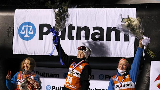 Renee McElduff, center, of Australia celebrates her win, with Veronika Korsunova, left, of Russia, who was second and Hanna Huskova, of Belarus, who was third in the freestyle World Cup aerials competition  on Saturday, Jan. 31, 2015, in Lake Placid, N.Y. (AP Photo/Mel Evans)