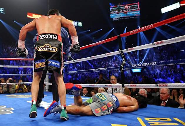 LAS VEGAS, NV - DECEMBER 08: Manny Pacquiao lays face down on the mat after being knocked out in the sixth round by Juan Manuel Marquez during their welterweight bout at the MGM Grand Garden Arena on December 8, 2012 in Las Vegas, Nevada. (Photo by Al Bello/Getty Images)