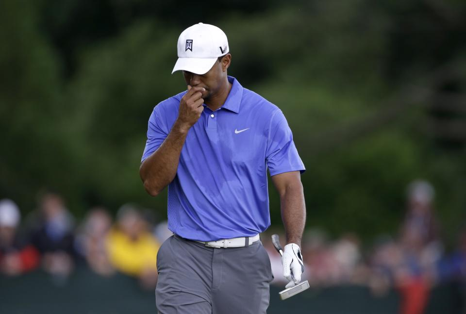 Tiger Woods walks down the second fairway after hitting out of a bunker during the first round of the U.S. Open golf tournament at Merion Golf Club, Thursday, June 13, 2013, in Ardmore, Pa. (AP Photo/Darron Cummings)