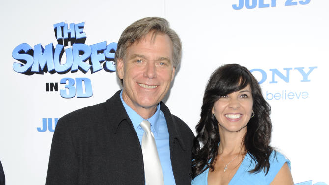 "Director Raja Gosnell, left, and wife attend the premiere of ""The Smurfs"" at the Ziegfeld Theatre on Sunday, July 24, 2011 in New York. (AP Photo/Evan Agostini)"
