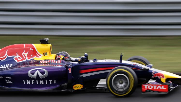 Red Bull Formula One driver Sebastian Vettel of Germany pilots his car during the qualifying session of the Hungarian Grand Prix at the Hungaroring circuit