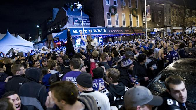 Baltimore Ravens fans celebrate in the streets in downtown Baltimore after their team won the NFL football Super Bowl in a game against the San Francisco 49ers, Sunday, Feb. 3, 2013. (AP Photo/Jose Luis Magana)