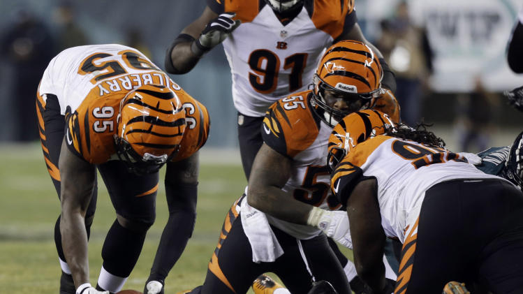 Cincinnati Bengals' Wallace Gilberry, left, recovers a fumble by the Philadelphia Eagles in the second half of an NFL football game, Thursday, Dec. 13, 2012, in Philadelphia. Gilberry returned the fumble for a touchdown. (AP Photo/Mel Evans)