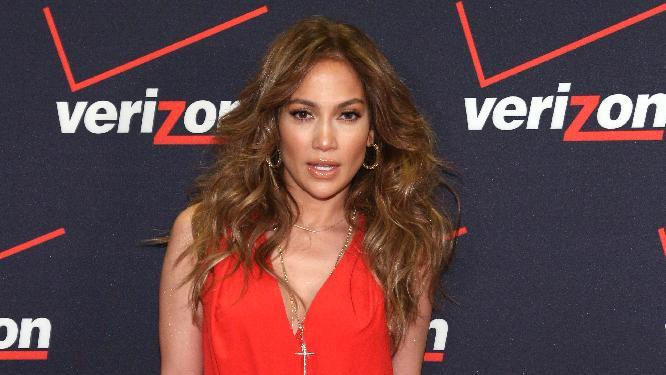 IMAGE DISTRIBUTED FOR VERIZON WIRELESS - Jennifer Lopez is seen at the Verizon Wireless meet Jennifer Lopez Flyaway Contest, on Saturday, Jan. 26, 2013 in Santa Monica, Calif. (Photo by Casey Rodgers/Invision for Verizon Wireless/AP Images)