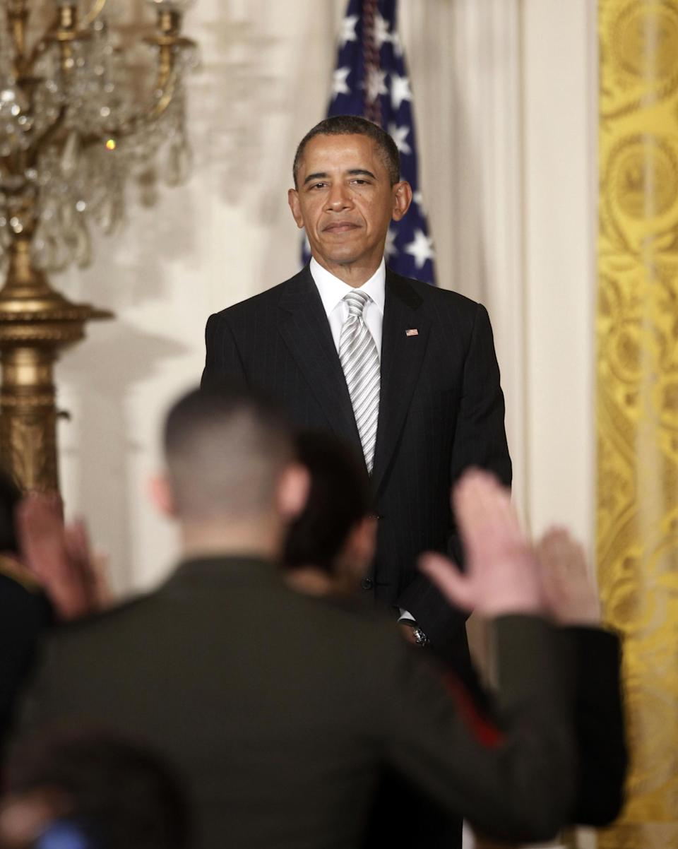 President Barack Obama watches as the Oath of Allegiance is administered at a naturalization ceremony for active duty service members and civilians, Monday, March 25, 2013, in the East Room of the White House in Washington. (AP Photo/Pablo Martinez Monsivais)
