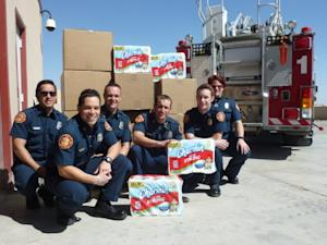 Photo of Rio Rancho Fire Department Receiving a Donation of Charmin Ultra Strong Toilet Paper Available on Business Wire's Website and AP PhotoExpress