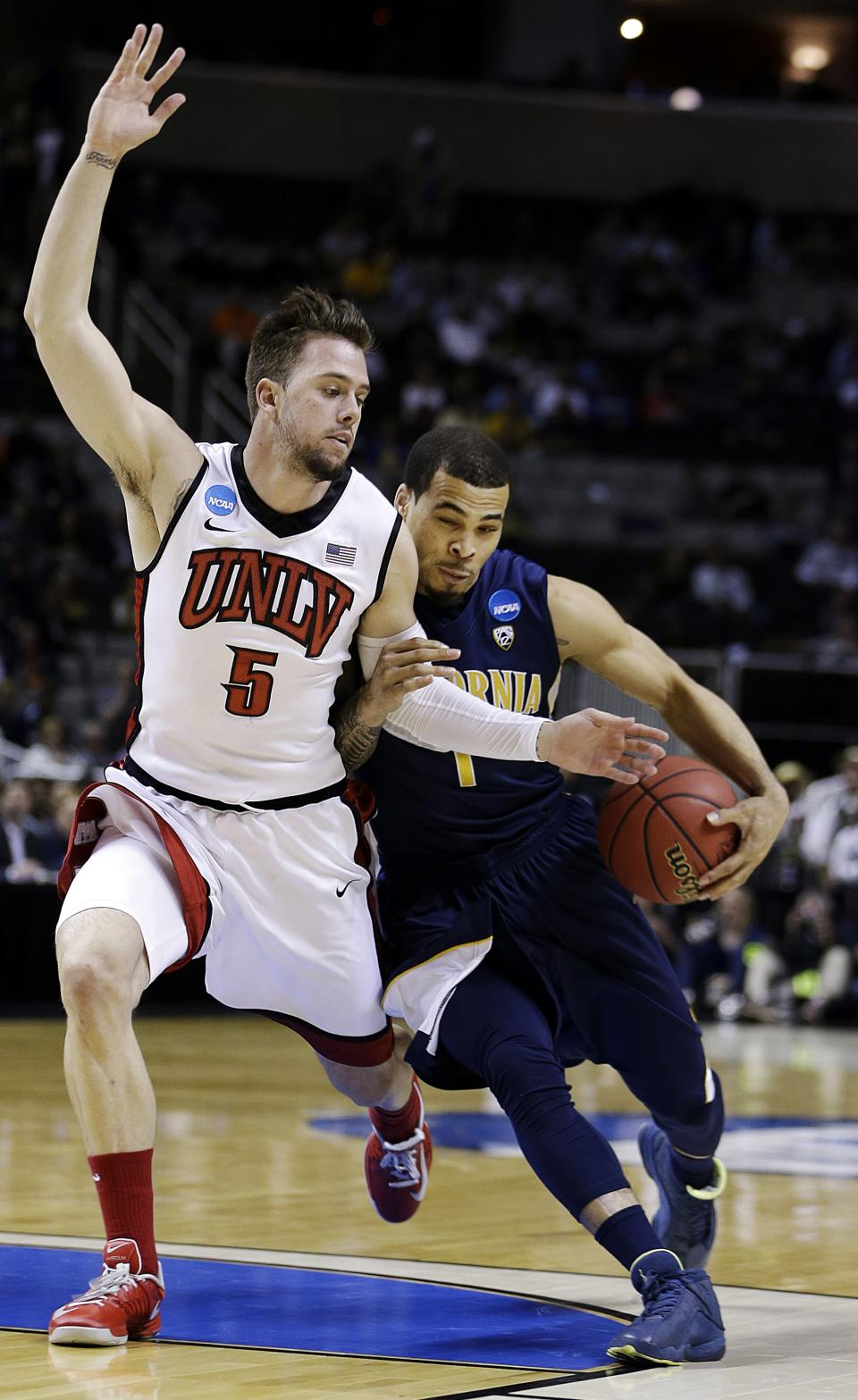 California guard Justin Cobbs, right, drives on UNLV guard Katin Reinhardt (5) during the first half of a second-round game in the NCAA college basketball tournament in San Jose, Calif., Thursday, March 21, 2013. (AP Photo/Ben Margot)