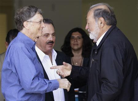 Mexican businessman Slim speaks with Microsoft founder and philanthropist Gates after taking part in the inauguration of a new research facility at the International Maize and Wheat Improvement Center in Texcoco