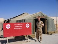 This file photo shows a senior official of the British Army Field Hospital at Camp Bastion, standing near the entrance of the hospital, in Helmand province, in 2007. A British soldier serving on the frontline in Afghanistan has given birth at the base, days after it came under attack from the Taliban, according to the defence ministry