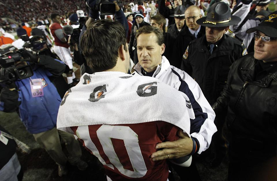Auburn coach Gene Chizik congratulates Alabama quarterback AJ McCarron (10)following a NCAA college football game at Bryant-Denny Stadium in Tuscaloosa, Ala., Saturday, Nov. 24, 2012. Alabama beat Auburn 49-0. (AP Photo/Butch Dill)