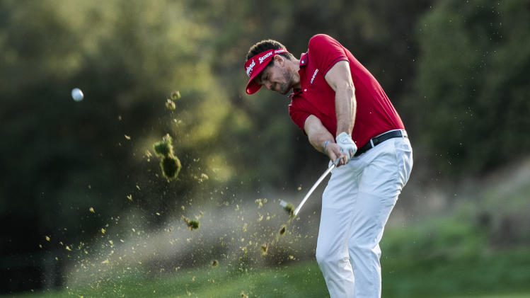 Keegan Bradley hits his second shot on the 18th hole during the final round of the World Challenge golf tournament at Sherwood Country Club in Thousand Oaks, Calif., Sunday, Dec. 2, 2012. (AP Photo/Bret Hartman)