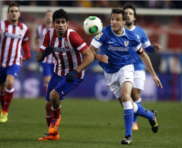 Atletico Madrid's Costa and Athletic Bilbao's Gurpegui fight for the ball during their Spanish King's Cup quarter-final first leg soccer match in Madrid