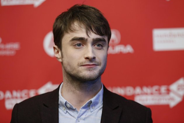 "File - Actor Daniel Radcliffe poses at the premiere of ""Kill Your Darlings"" during the 2013 Sundance Film Festival on Friday, Jan. 18, 2013 in Park City, Utah. Radcliffe has really left Harry Potter behind with a startling and explicit Sundance Film Festival role as poet Allen Ginsberg that puts Radcliffe into daring territory. (Photo by Danny Moloshok/Invision/AP, file)"