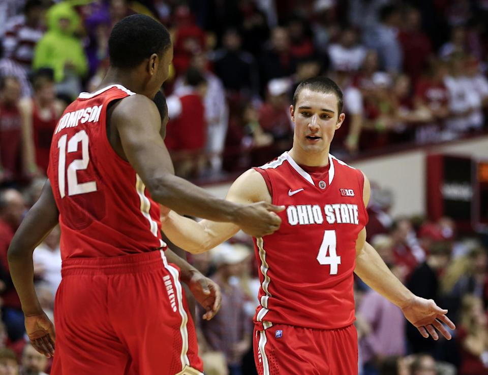 Ohio State's Aaron Craft (4) and Sam Thompson celebrate late in the second half of an NCAA college basketball game against Indiana, Tuesday, March 5, 2013, in Bloomington, Ind. Ohio State won 67-58. (AP Photo/Darron Cummings)
