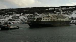 The tug Charlene Hunt tows the Lyubov Orlova out of St. John's Harbour on Jan. 23.