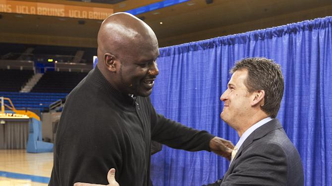 Shaquille O'Neal, left, congratulates UCLA's new men's basketball coach, Steve Alford, at a news conference at UCLA's Pauley Pavilion in Los Angeles Tuesday, April 2, 2013. Alford was hired as UCLA basketball coach on Saturday, spurning New Mexico days after he agreed to a new 10-year deal with the Lobos. (AP Photo/Damian Dovarganes)