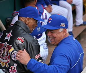 Chicago Cubs manager Rick Renteria (R) shares a laugh …