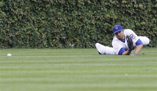Cardinals blow late lead, lose 5-4 to Cubs in 11