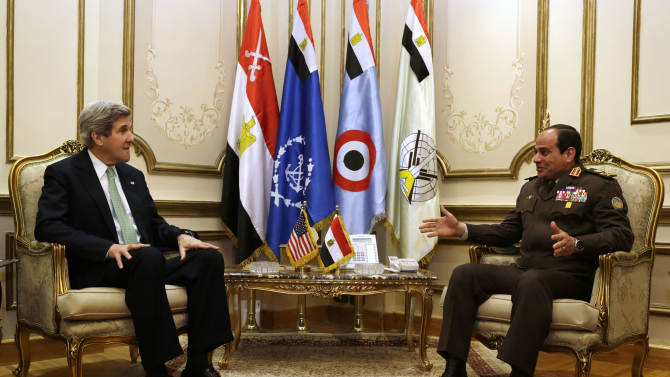 U.S. Secretary of State John Kerry, left, meets with Egyptian Defense Minister Abdel Fattah al-Sisi at the Ministry of Defense in Cairo, Egypt on Sunday, March 3, 2013. Secretary of State John Kerry is wrapping up a visit to Egypt with an appeal for unity and reform to the country's president and military chief. (AP Photo/Jacquelyn Martin, Pool)