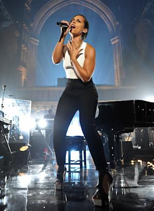 "This image made available Tuesday Sept. 25, 2012 by MTV Crashes Manchester shows Alicia Keys headlining ""MTV Crashes Manchester"" in the city's cathedral, Manchester, England Monday night Sept, 24, 2012. The 14-time Grammy Award winning singer and songwriter said performing in a place of worship was ""a real honor"" and added that there was ""an energy there that's very different."" Alongside old favorites, Keys on Monday night treated the 1,000-strong U.K. crowd to songs from her highly anticipated new album ""Girl on Fire,"" saying afterward that it was incredible to see people get into the new tracks.  (AP Photo/Andrew Timms/MTV Crashes Manchester, HO)  NO SALES, EDITORIAL USE ONLY, MANDATORY CREDIT."