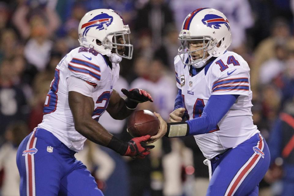 Buffalo Bills quarterback Ryan Fitzpatrick (14) hands off the ball to running back C.J. Spiller during the first half of an NFL football game against the Miami Dolphins, Thursday, Nov. 15, 2012, in Orchard Park, N.Y. (AP Photo/Bill Wippert)