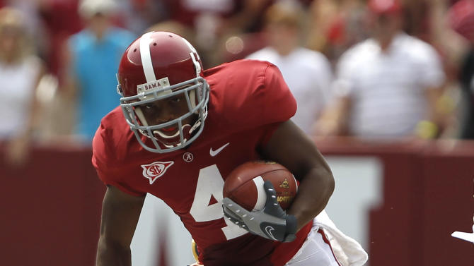 Alabama wide receiver Marquis Maze (4) breaks past Kent State Leon Green (3) for a big punt return during the first half of an NCAA college football game on  Saturday, Sept. 3, 2011 in Tuscaloosa, Ala.  (AP Photo/Butch Dill)