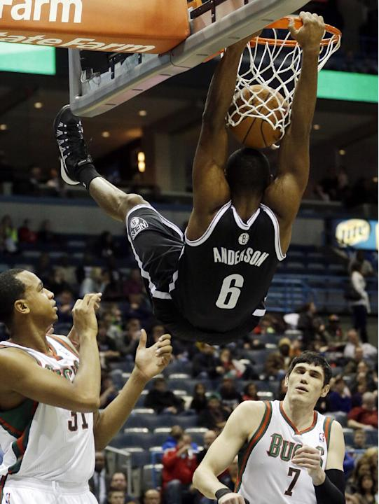 Brooklyn Nets' Alan Anderson dunks during the first half of an NBA basketball game against the Milwaukee Bucks Saturday, Dec. 7, 2013, in Milwaukee