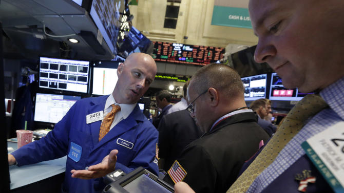 In this Tuesday, Aug. 13, 2013 photo, specialist John O'Hara, left, works with traders at his post on the floor of the New York Stock Exchange. U.S. stock futures are edging higher Tuesday, Aug. 20, 2013, after a four-day sell-off that shaved more than 300 points off the Dow Jones industrial average. (AP Photo/Richard Drew)