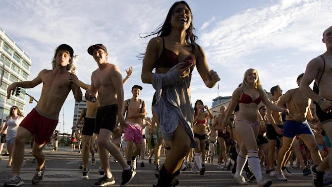 "In this photo taken Sept. 24, 2011, people run in their underwear from the Gallivan Center to the Capitol in Salt Lake City. Thousands of people stripped to their underwear and ran through Salt Lake City to protest what they called the ""uptight"" laws of Utah. (AP Photo/The Salt Lake Tribune, Djamila Grossman)"