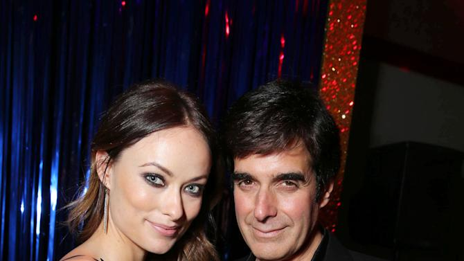 Olivia Wilde and David Copperfield at New Line Cinema's World Premiere of 'The Incredible Burt Wonderstone' held at Grauman's Chinese Theatre on Monday, Mar., 11, 2013 in Los Angeles. (Photo by Eric Charbonneau/Invision for New Line Cinema/AP Images)